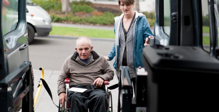 Wheelchair user using an adapted vehicle
