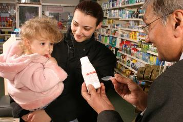 pharmacist talking to mum and daughter