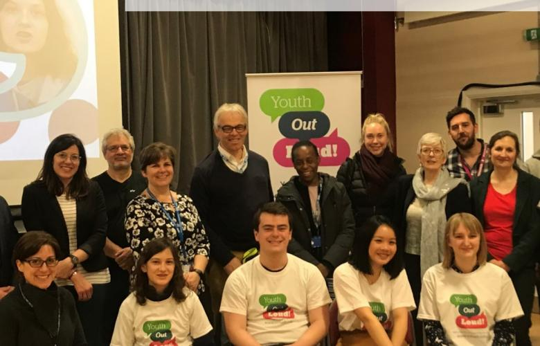 Guided by you: Annual report 2019-20 cover page. Young people and various staff at the Youth Out Loud! Launch