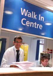staff at reception of walk in centre