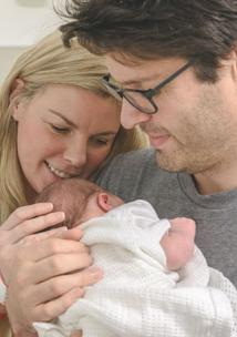 New parents with their newborn baby